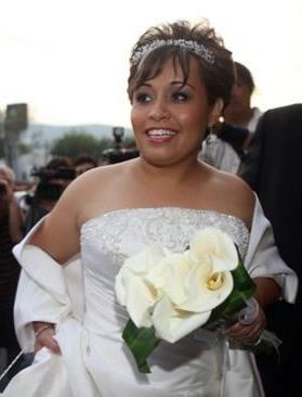 Claudia Solis in wedding dress
