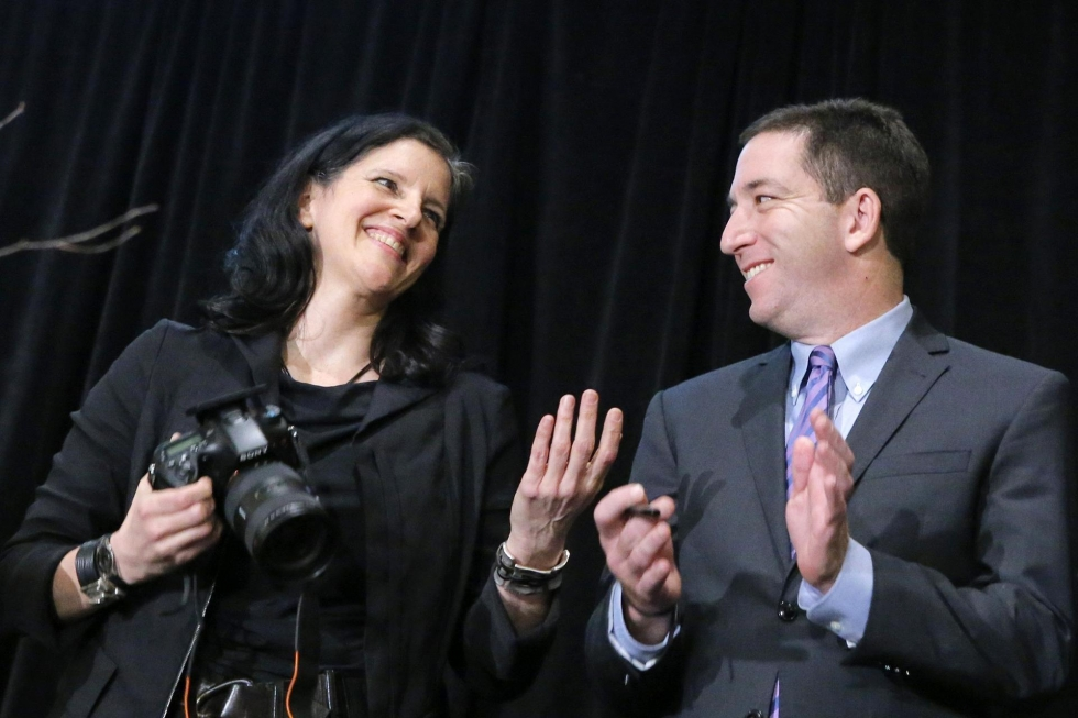 Laura Poitras and Glenn Greenwald receive an award for national security reporting for their stories on the spy programmes. (Photo: Reuters)