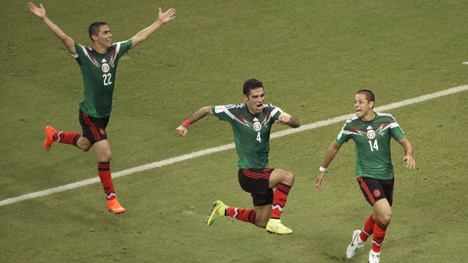 Mexico's Rafael Marquez  (4) celebrates scoring his side's first goal during the group A World Cup soccer match between Croatia and Mexico at the Arena Pernambuco in Recife, Brazil, Monday, June 23, 2014. (AP Photo/Hassan Ammar)