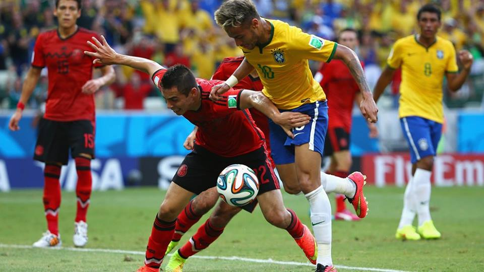 Neymar battles with Paul Aguilar in the game between Mexico and Brazil (Photo credit FIFA)