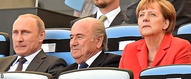 Fifa president Sepp Blatter is by Russia President Vladimir Putin and German Chancellor Angela Merkel