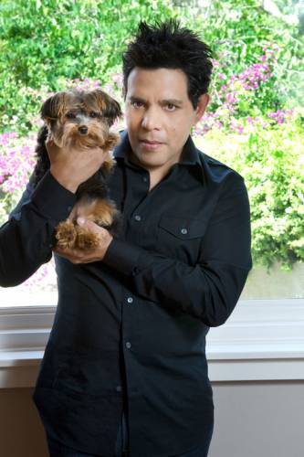 Actor and film director Raul Julia Levy and his Yorkshire dog