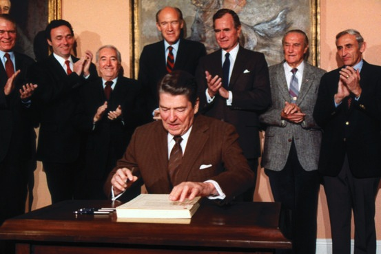 President Reagan signs immigration amnesty bill in November 1986