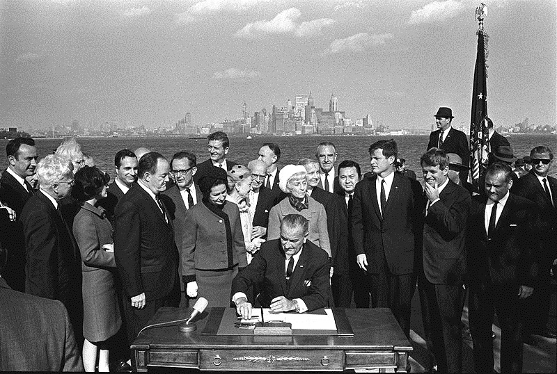 President Johnson signs the 1965 Immigration Bill