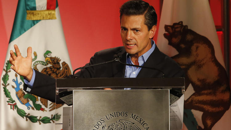 Mexico's President Enrique Pena Nieto speaks to Mexican American community leaders and others in Los Angeles on Aug. 25 during a two-day visit to California. (Damian Dovarganes / Associated Press)