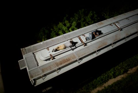 "In this Aug. 26, 2014 photo, Central American migrants sleep atop a moving freight train as it heads north from Arriaga toward Chahuites, Mexico. A Mexican crackdown seems to be keeping women and children off the deadly train, known as ""The Beast,"" that has traditionally helped thousands of migrants head north. The once-open route to the United States has become so difficult that trains now carry a small fraction of the migrants they used to, and almost exclusively adult men. (AP Photo/Rebecca Blackwell) (Rebecca Blackwell/AP)"