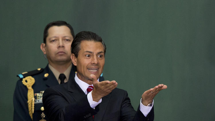 Mexican President Enrique Peña Nieto gestures during the signing ceremony for a historic energy reform bill at the National Palace in Mexico City on Monday. (Rebecca Blackwell / Associated Press)