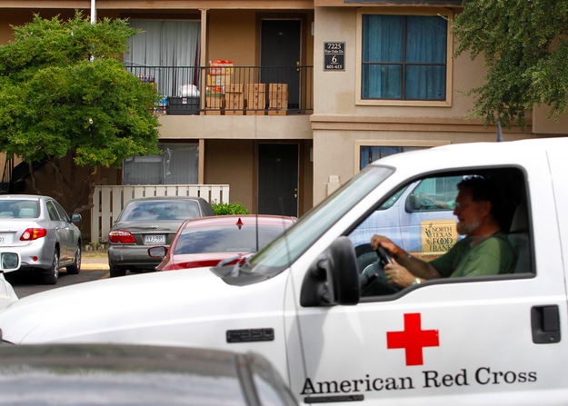 A Red Cross worker leaves after delivering food to Duncan's family's apartment unit in The Ivy Apartments. (Photo: Mike Stone  / Reuters)