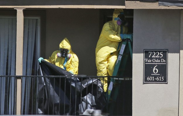 Hazardous material cleaners are seen Friday at the Dallas apartment where Thomas Eric Duncan stayed last week. (Photo: LM Otero / AP)