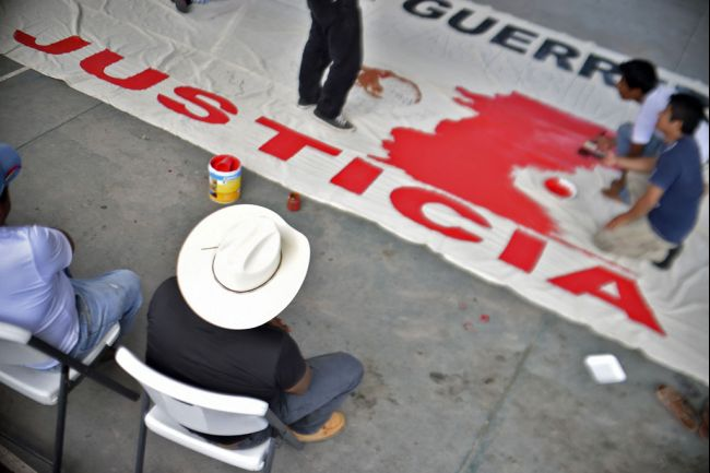 Students prepare a banner next to relatives of their killed and missing peers in Ayotzinapa, Guerrero state, Mexico on Oct. 5, 2014.