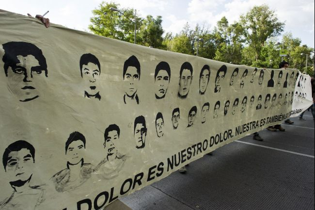 Protestors march with pictures of the missing students during a demonstration in Mexico City on Oct. 8, 2014, demanding justice in the case of the 43 students that went missing in Iguala, Guerrero state, last Sept. 26, after a clash with local police (Photo: globalpost.com)