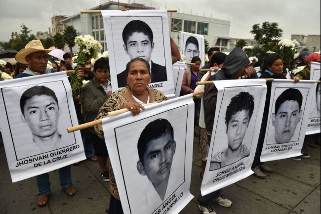 Relatives of the 43 missing students are seen arriving for a mass at Basilica of Guadalupe in Mexico City, on Oct. 19, 2014. (YURI CORTEZ/AFP/Getty Images)