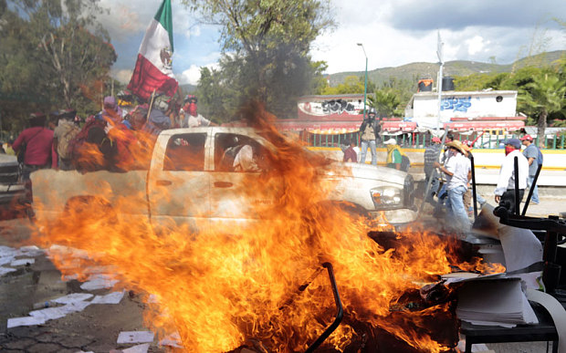 Violent protests have erupted in Mexico since authorities said hitmen confessed to murdering the students (Photo: Telegraph UK)