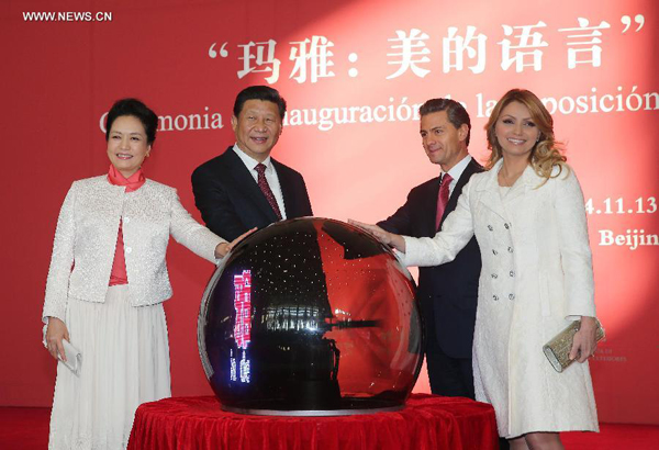 "Chinese President Xi Jinping (2nd L), his wife Peng Liyuan (1st L) and Mexico's President Enrique Pena Nieto (2nd R) and his wife jointly cut the ribbon at the opening ceremony of the ""Exhibition of Mayas: The Language of Beauty"" in the National Museum of China in Beijing, capital of China, Nov. 13, 2014. (Xinhua/Liu Weibing)"