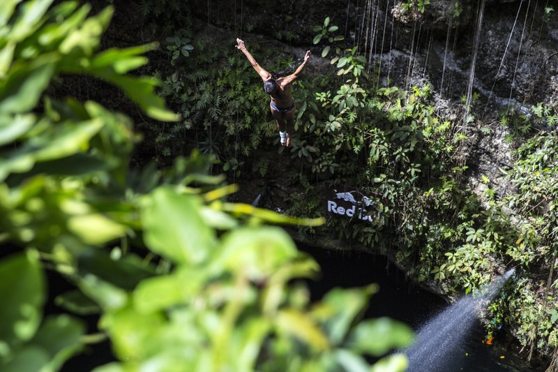 Orlando Duque of Colombia dives from the 27 metre platform during the seeding round of the seventh and final stop of the Red Bull Cliff Diving World Series, Ik Kil cenote, Yucatan, Mexico, on October 18th 2014.