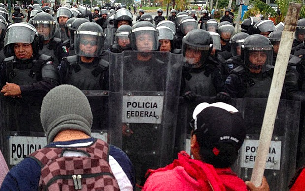 Police and protesters clash in Mexico (Photo: http://www.telegraph.co.uk/)