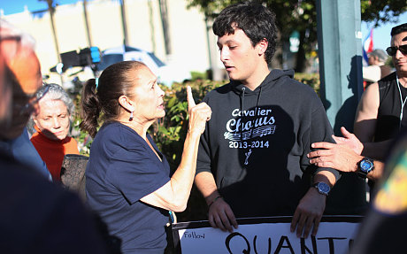 Miriam Clemente debates with Bryan Medina, right, about President Obama's new policy (Getty)