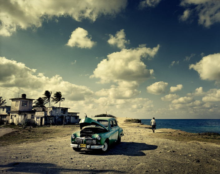 An old American car, long a staple of Cuban roads, sits along Guanabo Beach, near Havana (Photo: Time.com)