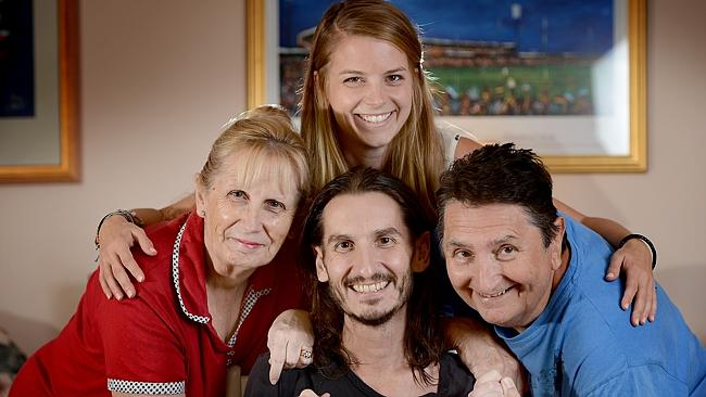 A happy ending...  Ryan Maudlen,  back home in Adelaide with his parents Deb and Rob and girlfriend Katharina Reigl. Photo: Roy Van Der Vegt.