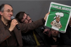 "The front page of the first edition of Charlie Hebdo since Islamist gunmen attacked the satirical newspaper shows a caricature of Prophet Mohammad holding a sign saying ""Je suis Charlie"" . (Photo: Reuters )"