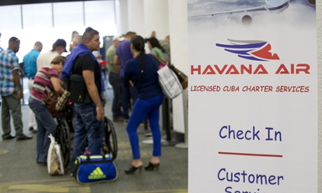 Travellers line up to check in for charter flights from Miami to Havana at Miami International Airport on Friday. Photograph: Wilfredo Lee/Associated Press
