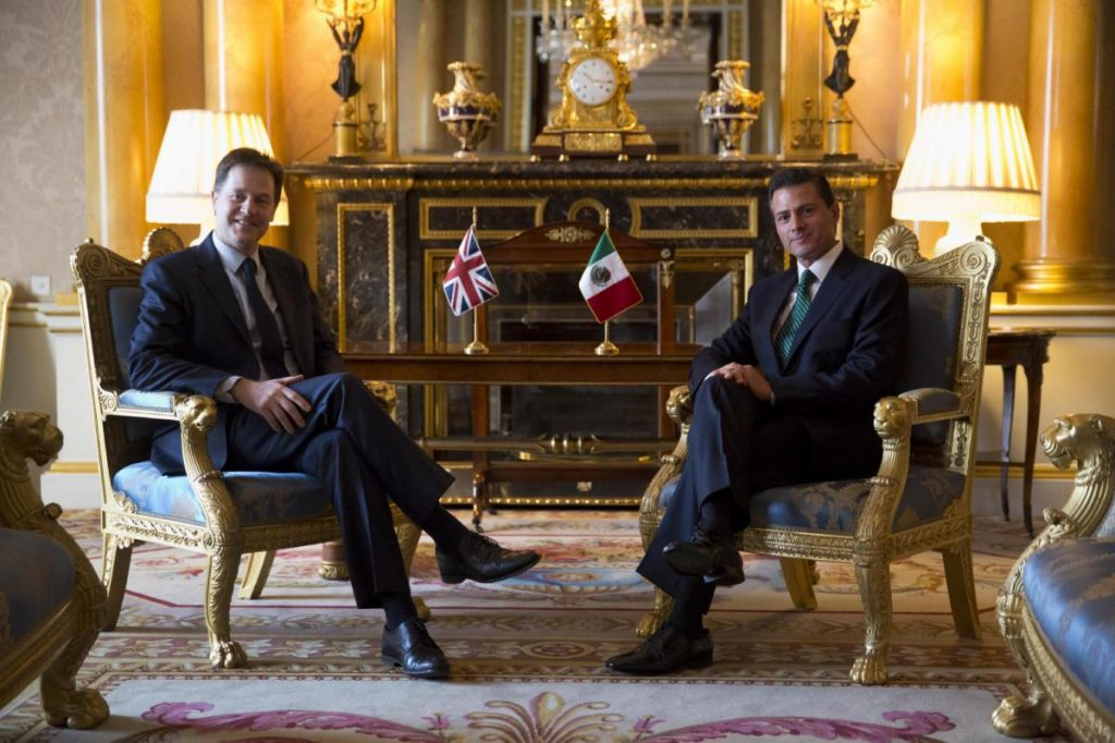 Mexican President Enrique Pena Nieto, right, and British Deputy Prime Minister and leader of the Liberal Democrats party Nick Clegg