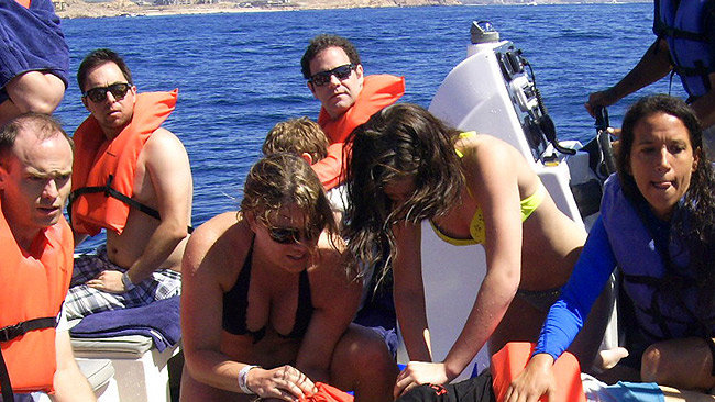 Tourists help a Calgary woman after she was hit by a whale in Los Cabos, in this picture released to Reuters on March 12, 2015 by Mexico's federal attorney general's office for environmental protection (PROFEPA). (REUTERS/Profepa/Handout via Reuters)