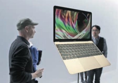 Apple guests get a look at the new Macbook in San Francisco. AP Photo/Eric Risberg