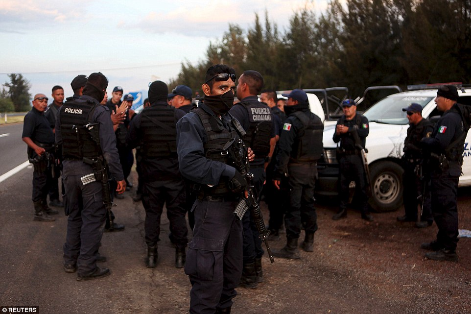 Federal police (pictured) and dozens of suspected gang members fought intensely for three hours at a ranch in southwestern Mexico (Photo: Daily Mail)