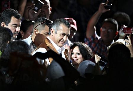 Jaime Rodriguez (C), independent candidate for governor of Nuevo Leon state, is greeted by supporters during his closing campaign rally in Monterrey, May 31, 2015. REUTERS