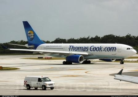 Thomas Cook Airplane landing at Cancun Airport (Jetfoto.net)