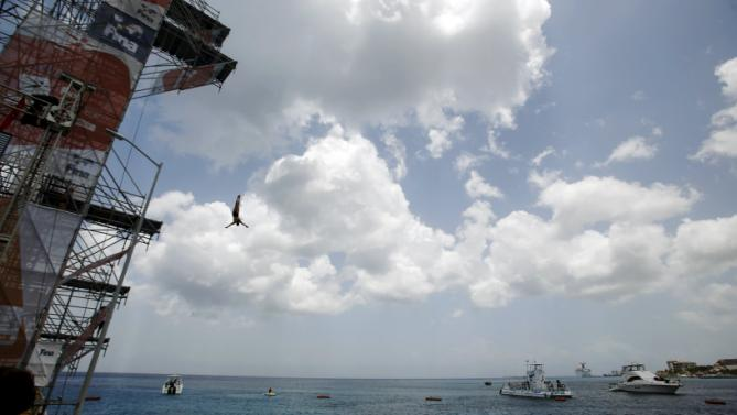 Yana Nestsiarava from Belarus performs a high dive during the second FINA High Diving World Cup in Cozumel, Mexico, May 9, 2015. (REUTERS/Victor Ruiz Garcia)
