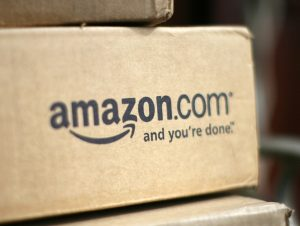 A box from Amazon.com is pictured on the porch of a house (Photo: REUTERS/Rick Wilking/Files)