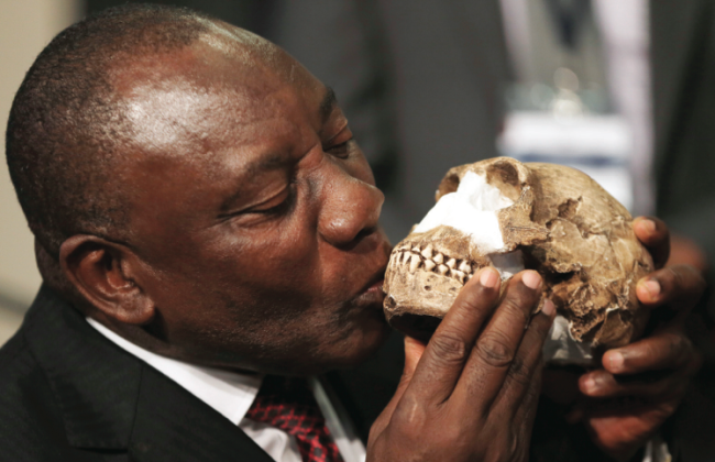 Deputy President Cyril Ramaphosa kisses a skull reconstruction. (AP PHOTO_THEMBA HADEBE)