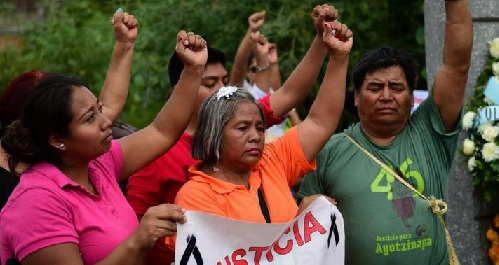 Relatives and friends of 43 missing students in Mexico demonstrate in Iguala, Guerrero state, on Sept. 27 to commemorate the first anniversary of their disappearance. (Ronaldo Schemidt / AFP/Getty Images)