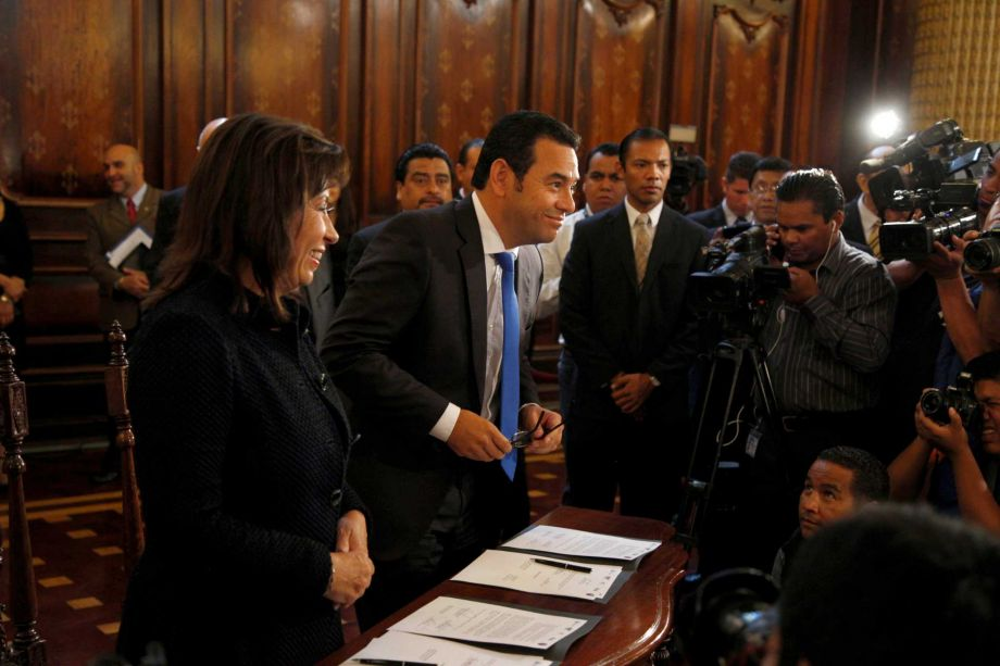 Presidential candidate, former first lady Sandra Torres, left, stands before photographers next to her rival comedian Jimmy Morales before they sign a pact to respect governmental institutions during a meeting with the current president at the National Palace in Guatemala City, Thursday, Oct. 22, 2015. (Photo: SFGate)