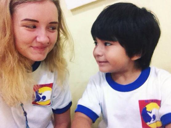Sophie, English teacher from the UK, with Aaron,  local student.