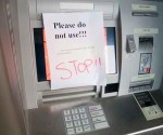 Photo: themarysue.com ATM scammers use PIN-capturing devices to clone cards.