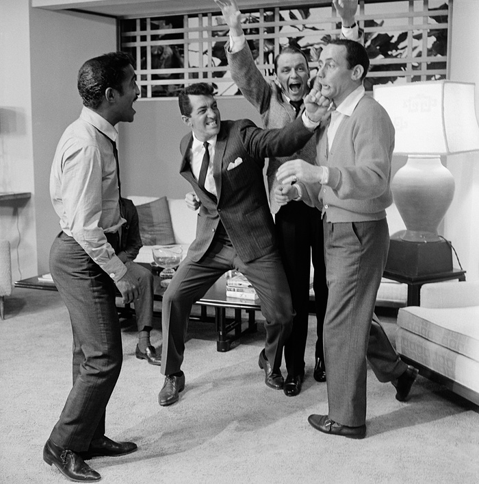 Mock fights and late nights...The Rat Pack goofing around.