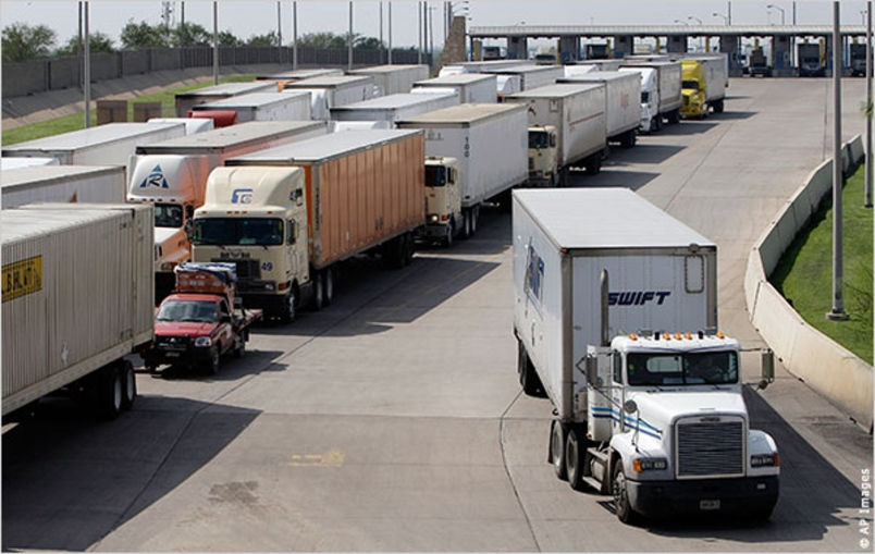 Trucks line up at the Mexico-U.S. border. For the first time, U.S. border authorities will inspect trucks entering the United States on Mexican soil (Photo: stripes.com)