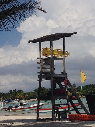 Lifeguard watches over swimmers and snorkelers in Akumal Bay (Photo: Akumal)