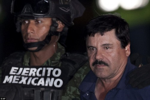 El Chapo showed little emotion as he was dragged across the runway in front of dozens of Press and government officials (AP)
