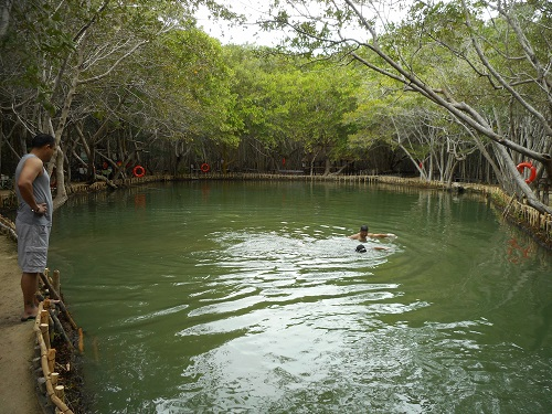 Swimmers enjoy cenote at El Corchito Ecological Reserve. (PHOTO: Robert Adams)