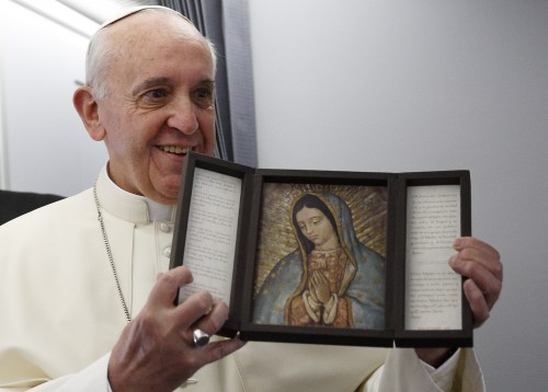 Pope Francis holds an image of Our Lady of Guadalupe, Mexico patron saint. (CNS photo/Paul Haring) See VATICAN LETTER April 16, 2015.