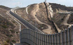 This recent Getty Images file photo shows a section of existing border wall near San Diego, Calif. (PHOTO: america.aljazeera.com)