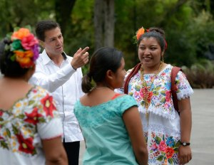President Enrique Pena Nieto with indigenous women from Yucatan who flew on presidential jet to Mexico City. (PHOTO: laht.com)