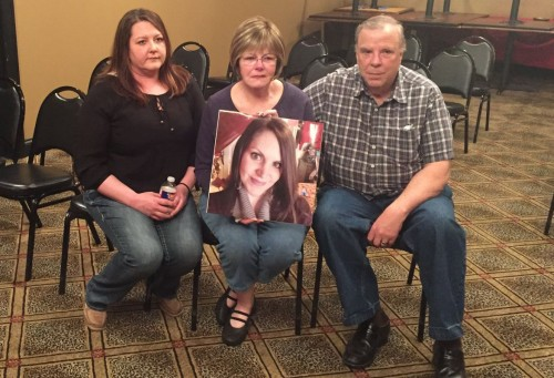 Tamra Turpin's sister, mother and stepfather hold her photo at a news conference Wednesday March 9 in Missouri. (PHOTO: stltoday.com)