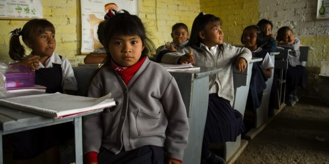 Students and teachers at the Nicolas Guillen elementary school in the lower class Nueva Tepalcate barrio in the city of Chimalhuacan, State of Mexico. Mexico. The school consists of eight small, provisional classrooms without electricity for 170 students. (Photo: Vallarta Daily)