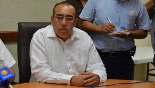 Quintana Roo Attorney General Carlos Alvarez Escalera announced the 14 arrests at a press conference Thursday March 31. (photo: periodistasquintanaroo.com)