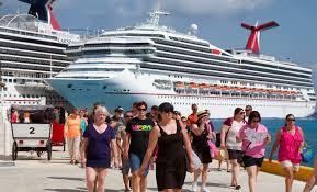 Cruise passengers disembark at Cozumel. (PHOTO: wolfscompany.com)